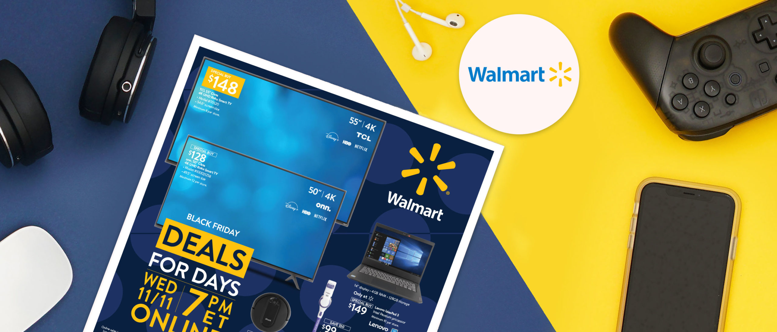 Walmart flyer on blue and yellow tabletop surrounded by electronics.