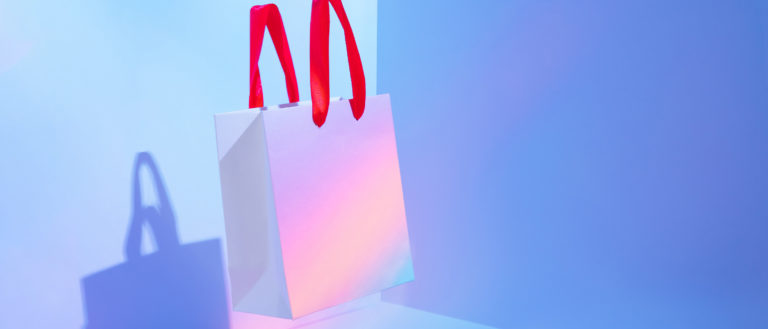 White paper shopping gift bag on chrome background