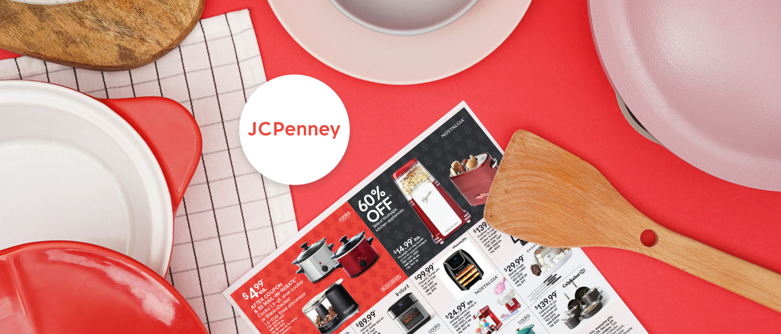 JCPenney flyer on red background surrounded by cooking utensils